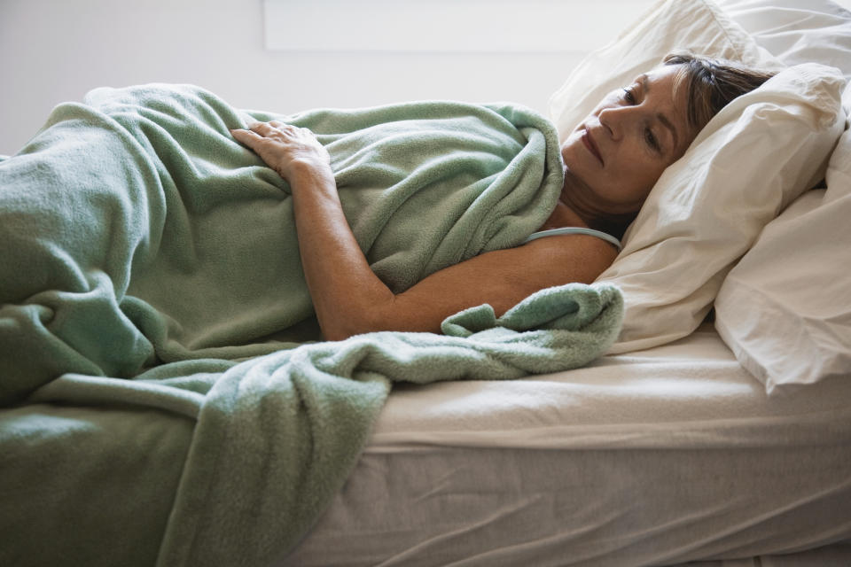Woman lying in bed, trying to sleep