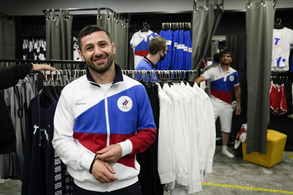 Russian athletes try on the new Olympic sportswear for the Tokyo Games by the brand ZASPORT in Moscow, Russia, Thursday, July 1, 2021. (AP Photo/Alexander Zemlianichenko)
