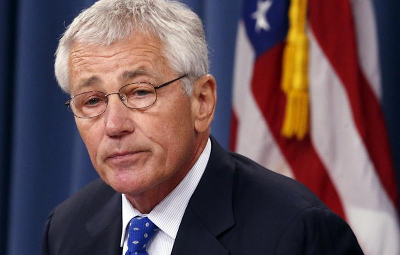 Defense Secretary Chuck Hagel speaks during a news conference at The Pentagon, Wednesday, Sept. 18, 2013. Hagel is ordering the Pentagon to review the physical security of all U.S. defense facilities worldwide and the security clearances that allow access to them. Hagel ordered the reviews in response to Monday's shooting rampage at the Washington Navy Yard, where a dozen people were killed. The shooter, Aaron Alexis, also was killed. (AP Photo/Charles Dharapak)