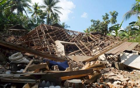 Houses damaged by an earthquake are seen in North Lombok, Indonesia - Credit: AP