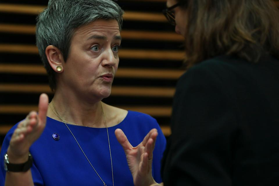 European Competition Commissioner Margrethe Vestager, left, talks to Trade Commissioner Cecilia Malmstrom prior the weekly College of Commissioners meeting at EU headquarters in Brussels, Wednesday, Feb. 6, 2019. (AP Photo/Francisco Seco)