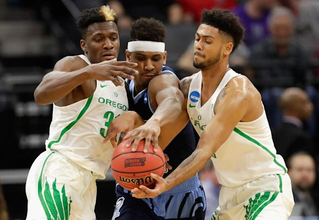 "<span class=""element-image__caption"">Oregon's Dylan Ennis and Tyler Dorsey put the squeeze on Rhode Island to book a spot in the Sweet 16.</span> <span class=""element-image__credit"">Photograph: Jamie Squire/Getty Images</span>"