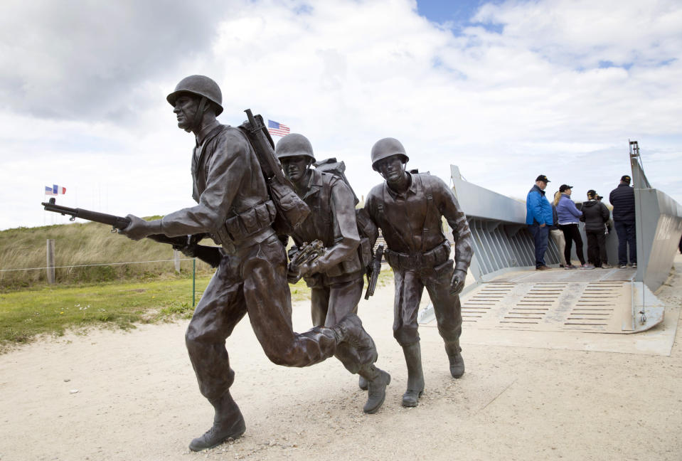 In this May 2, 2019 photo, a statue of U.S. World War II soldiers departing a replica landing craft on Utah Beach in Sainte-Marie-du-Mont, Normandy, France. A dwindling number of D-Day veterans will be on hand in Normandy in June, when international leaders gather to honor them on the invasion's 75th anniversary. (AP Photo/Virginia Mayo)