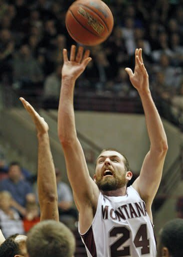Montana forward Derek Selvig (24) goes up for 2 points against Weber State during the first half of an NCAA college basketball game at the Big Sky tournament in Missoula, Mont., on Wednesday, March 7, 2012.(AP Photo/ Michael Albans