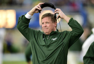 Jim McElwain looks on from the sideline during a game. (USAT)