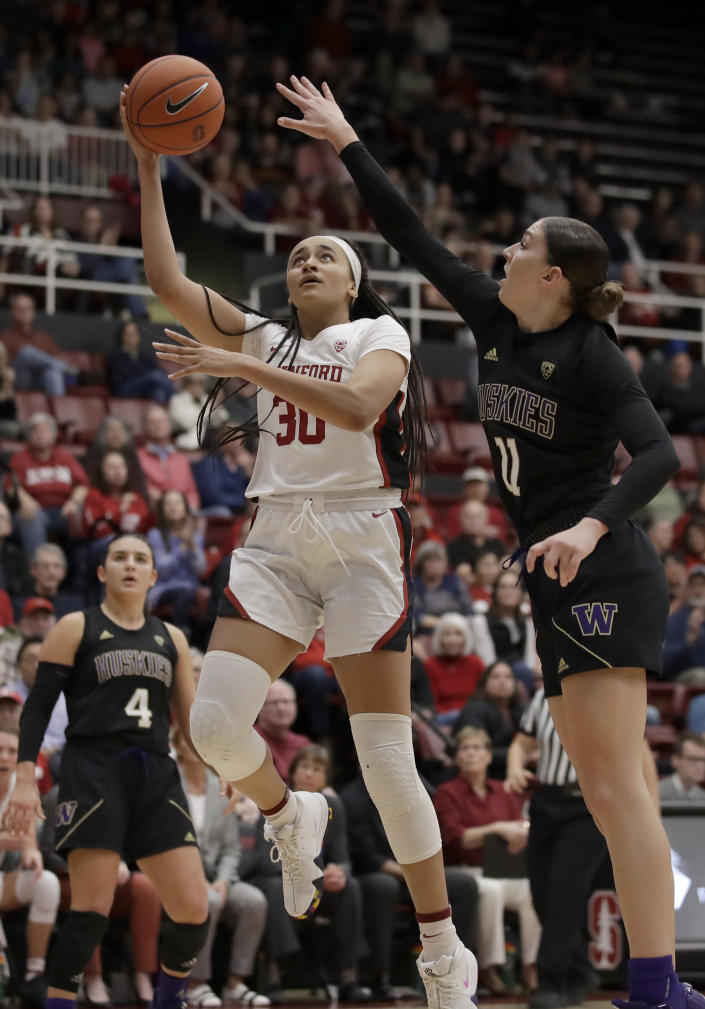 Stanford's Haley Jones, front left, shoots against Washington's Haley Van Dyke (11) in the second half of an NCAA college basketball game Sunday, Jan. 5, 2020, in Stanford, Calif. (AP Photo/Ben Margot)