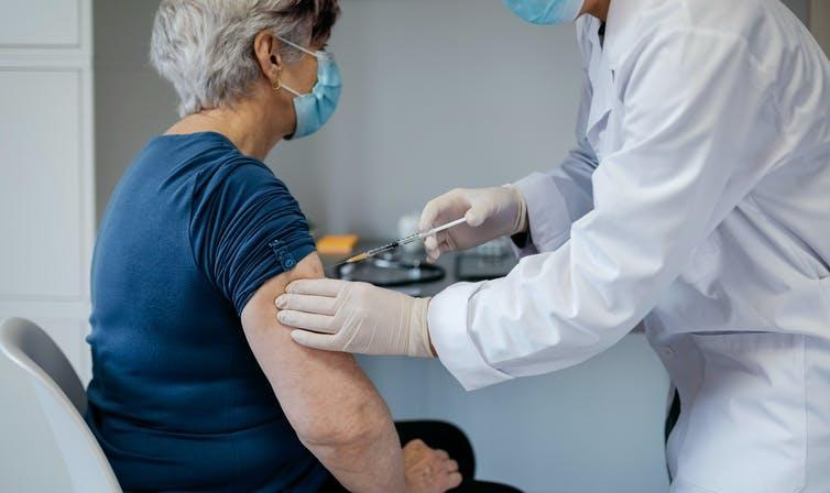An older woman being vaccinated