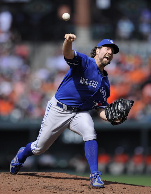 Toronto Blue Jays starter R.A. Dickey delivers a pitch against the Baltimore Orioles during the first inning of a baseball game, Saturday, June 14, 2014, in Baltimore. (AP Photo/Nick Wass)