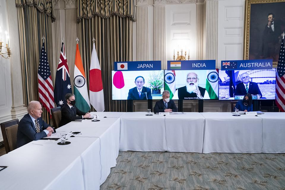 U.S. President Joe Biden, left, and Antony Blinken, U.S. secretary of state, second left, attend a virtual Quadrilateral Security Dialogue (Quad) meeting with leaders of Japan, Australia and India in the State Dining Room of the White House in Washington, D.C, U.S., on Friday, March 12, 2021. (Jim Lo Scalzo/EPA/Bloomberg via Getty Images)