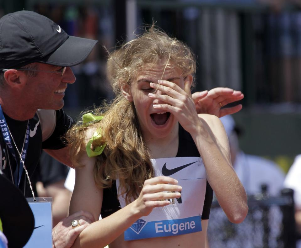 FILE - In this June 1, 2013, file photo, Mary Cain, 17, right, reacts as coach Alberto Salazar tells her she has just broken the American high school 800-meter record during the Prefontaine Classic track and field meet in Eugene, Ore. Nike will investigate allegations of abuse by runner Mary Cain while she was a member of Alberto Salazar's training group. Cain joined the disbanded Nike Oregon Project run by Salazar in 2013, soon after competing in the 1,500-meter final at track and field's world championships when she was 17. (AP Photo/Don Ryan, File)