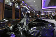 Baltimore Ravens guard James Hurst fills bags with items from his locker, Sunday, Jan. 12, 2020 in Owings Mills, MD. (AP Photo/Gail Burton)