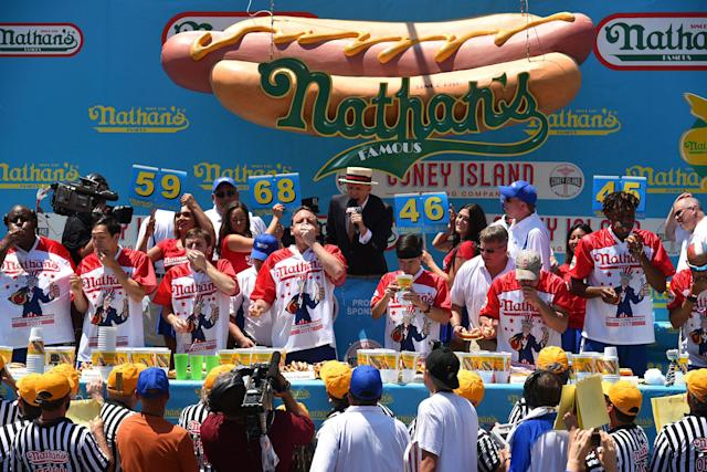 <p>Referees watch the competitors at Nathan's Famous Fourth of July International Hot Dog Eating Contest at Coney Island in Brooklyn, New York City, U.S., July 4, 2017. (Erik Pendzich/REX/Shutterstock) </p>