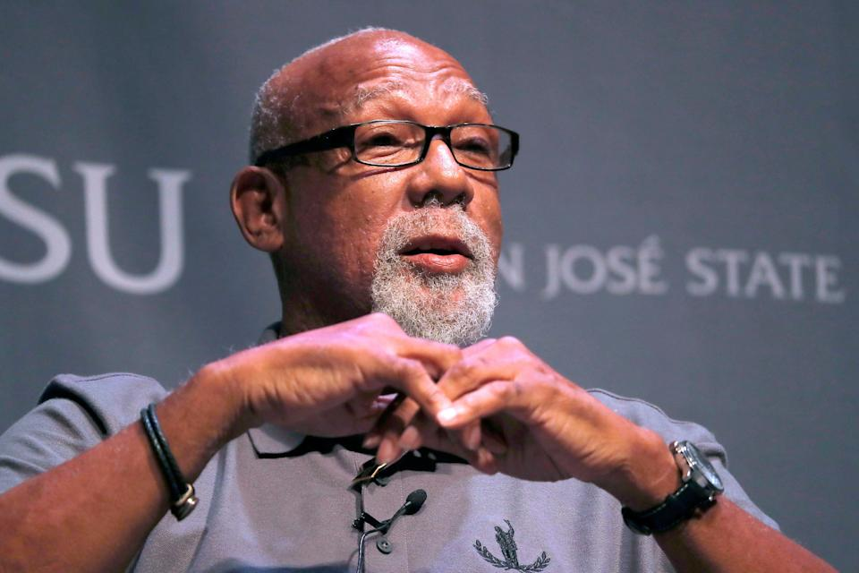 1968 Olympic athlete John Carlos speak about their experience as Olympians who participated in Mexico City in 1968 during the 50th Anniversary of the Defining Moment in Sports Social Activism Historic Town Hall at San Jose State University in San Jose, Calif., Wednesday, Oct. 17, 2018. Carlos and Tommie Smith gave a black-gloved salute on the medal stand at the 1968 Olympics in Mexico City. (AP Photo/Tony Avelar)