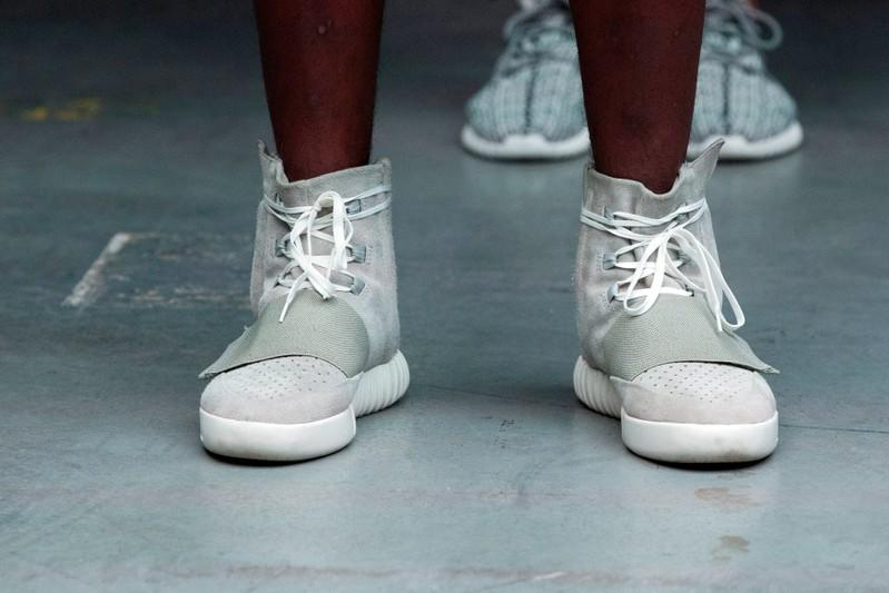FILE PHOTO: A model wears a pair of Adidas Yeezy 750 Boost shoes designed by Kanye West as part of his Fall/Winter 2015 partnership line with Adidas at New York Fashion Week