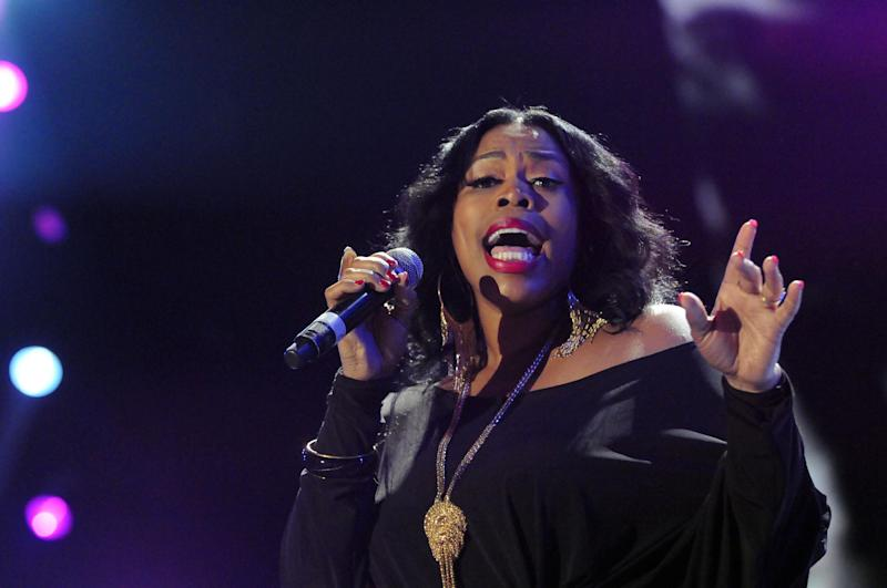 """FILE - In this July 8, 2012 file photo, Nicci Gilbert performs a tribute to Whitney Houston at the Essence Music Festival in New Orleans. TV reality show, """"R&B Divas,"""" which airs Mondays at 10 p.m. EDT has an episode that shows the women's tribute performance from the 2012 Essence Music Festival honoring Whitney Houston, Etta James and others. (Photo by Cheryl Gerber/Invision/AP, File)"""