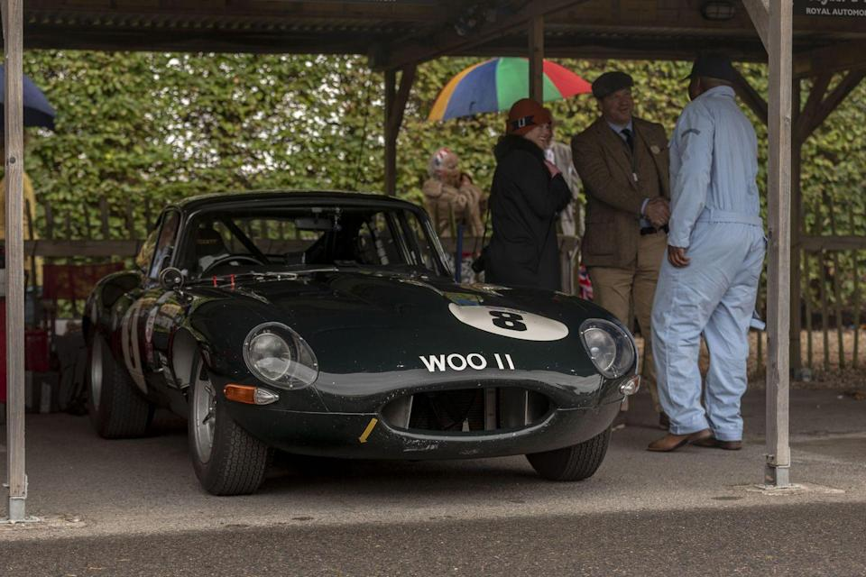 """<p>The first day there, I discovered an old friend would be there with her brother, Nikolaus Ditting, who brought a 1963 Jaguar E-type for the RAC TT and a 1960 Aston Martin DB4 GT for the Stirling Moss Memorial Trophy. The E-type has borne <a href=""""http://www.xkedata.com/gallery/zoom/?id=401373"""" rel=""""nofollow noopener"""" target=""""_blank"""" data-ylk=""""slk:its WOO 11 registration"""" class=""""link rapid-noclick-resp"""">its WOO 11 registration </a>since being <a href=""""http://forum.etypeuk.com/viewtopic.php?t=13339"""" rel=""""nofollow noopener"""" target=""""_blank"""" data-ylk=""""slk:raced by John Quick"""" class=""""link rapid-noclick-resp"""">raced by John Quick</a> and his friend and mechanic Stuart Davies in the 1960s and 1970s, and their names are still on the fenders. For Goodwood, Ditting shared driving duty with 74-year-old ex-F1 and endurance racing driver Jochen Mass, a driver as charming off the track as he is canny on it.</p>"""