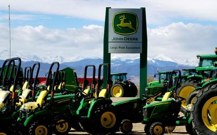 FILE PHOTO: John Deere tractors are seen for sale at a dealer in Longmont