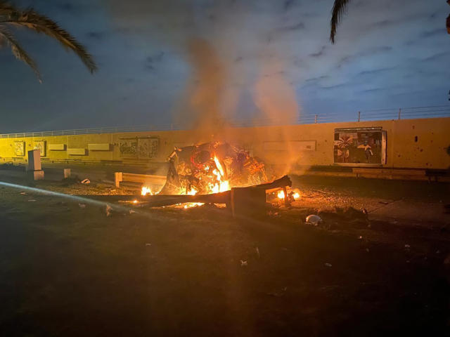 A burning vehicle at Baghdad International Airport following the airstrike (Iraqi Prime Minister Press Office via AP)