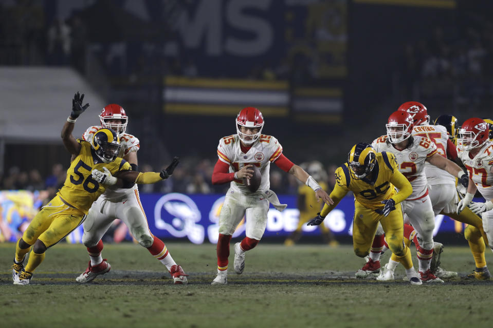 Kansas City Chiefs quarterback Patrick Mahomes (15) scrambles on a keeper play against the Los Angeles Rams during the second half of an NFL football game, Monday, Nov. 19, 2018, in Los Angeles. (AP Photo/Marcio Jose Sanchez)