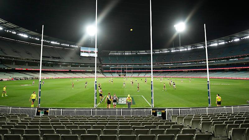 The AFL season, pictured here starting behind closed doors at the MCG.