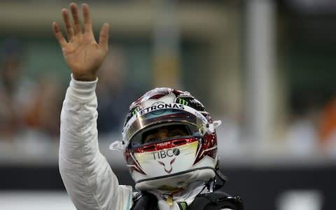 <span>Lewis Hamilton celebrates his pole position</span> <span>Credit: Getty Images </span>