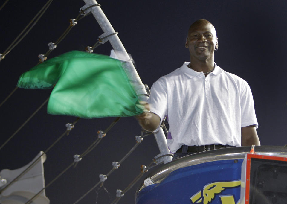 Charlotte Bobcats owner Michael Jordan practices waving the green flag before the NASCAR All-Star auto race at Charlotte Motor Speedway in Concord, N.C., Saturday, May 22, 2010. Jordan was the honorary starter for the race. (AP Photo/Chuck Burton)