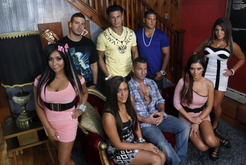 "FILE  - An Aug. 4, 2011 file photo shows the cast members of MTV's ""Jersey Shore"" at their television home in Seaside Heights, N.J.   Fans of sthe television show can rent the house for $2.500 a night.  (AP Photo/Mel Evans/file)"