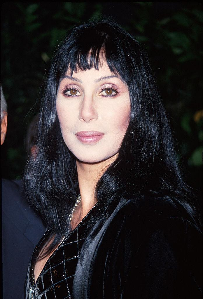 """<p>Cher was surprisingly understated in 1993 — the year she bravely teamed up with Beavis & Butt-Head for a <a href=""""http://www.dailymotion.com/video/x176hjt_cher-feat-beavis-and-butthead-i-got-you-babe-1993_music"""" rel=""""nofollow noopener"""" target=""""_blank"""" data-ylk=""""slk:special version"""" class=""""link rapid-noclick-resp"""">special version</a> of """"I Got You Babe"""" — with plumped pink lips, fringy bangs, and lashes for days. <i>(Photo: Getty Images)</i></p>"""