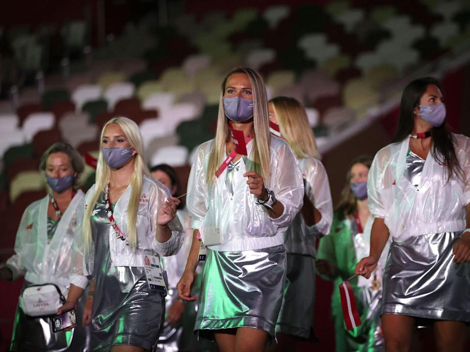 Athletes from Latvia make their entrance at the Summer Olympics.