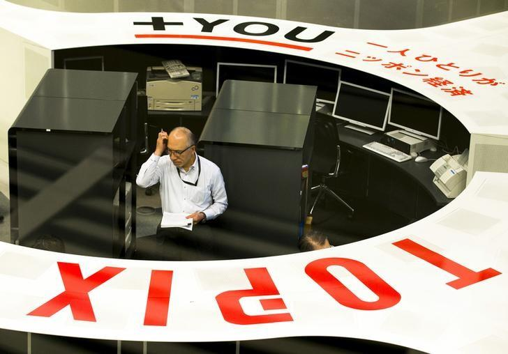 TSE employee looks at monitors at the Tokyo Stock Exchange in Tokyo