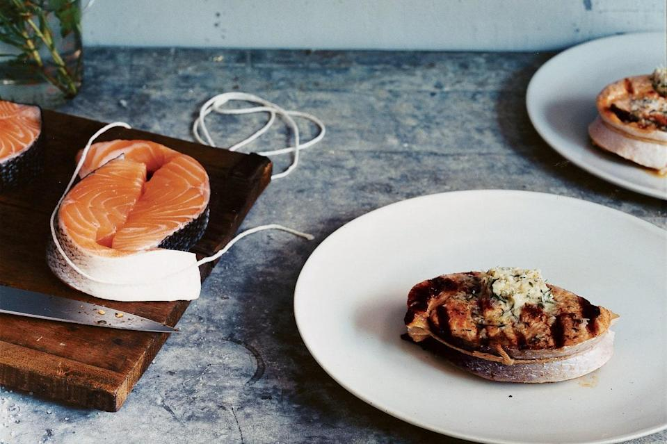 "Removing the bones from salmon steaks is surprisingly easy, and you'll get fillet-like quality at a lower price. Here, we've grilled the steaks to intensify their flavor, and paired them with the sharp bite of horseradish. <a href=""https://www.epicurious.com/recipes/food/views/grilled-boneless-salmon-steaks-with-horseradish-dill-butter-238702?mbid=synd_yahoo_rss"" rel=""nofollow noopener"" target=""_blank"" data-ylk=""slk:See recipe."" class=""link rapid-noclick-resp"">See recipe.</a>"