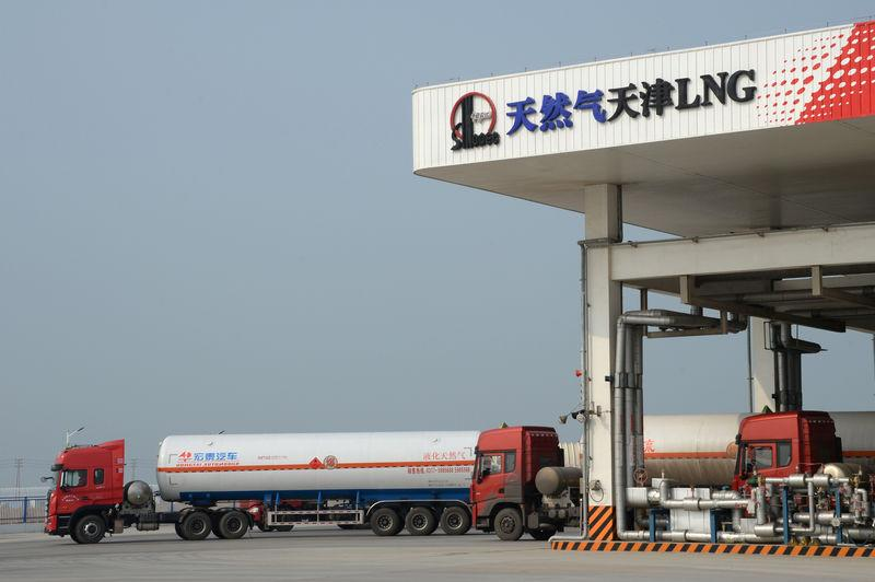 Trucks carrying liquefied natural gas (LNG) are seen at Sinopec's LNG terminal in Tianjin