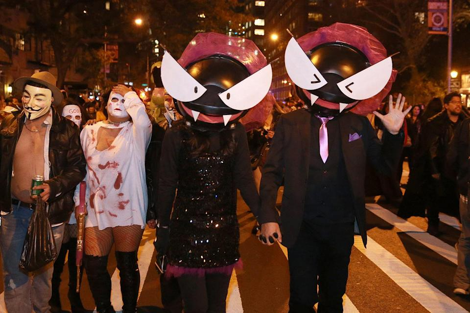 <p>People wear creepy cat-eye costumes at the 44th annual Village Halloween Parade in New York City on Oct. 31, 2017. (Photo: Gordon Donovan/Yahoo News) </p>