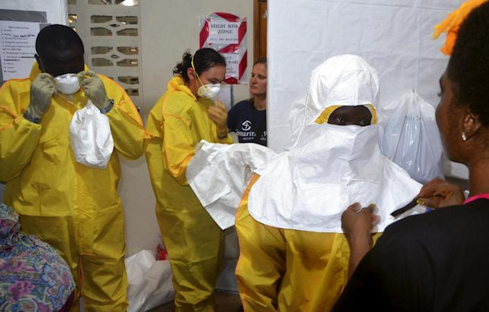 A picture taken on July 24, 2014 shows staff of the Christian charity Samaritan's Purse putting on protective gear in the ELWA hospital in the Liberian capital Monrovia (AFP Photo/Zoom Dosso)