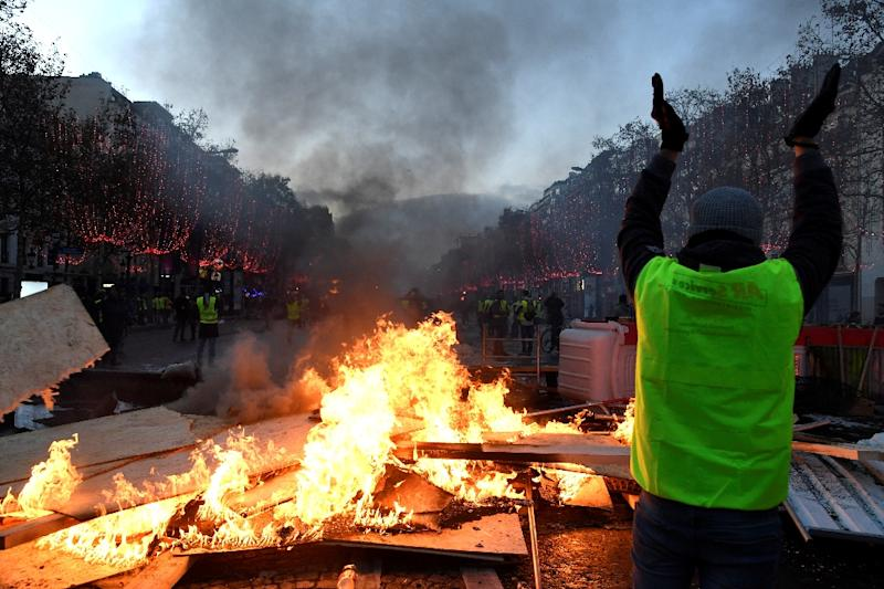 Macron acknowledges protests over fuel taxes, but won't change course