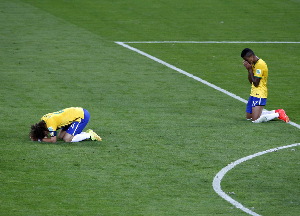 Brazil's David Luiz (L) and Luiz Gustavo react after losing their 2014 World Cup semi-finals against Germany at the Mineirao stadium in Belo Horizonte July 8, 2014. REUTERS/David Gray (BRAZIL  - Tags: SOCCER SPORT WORLD CUP)