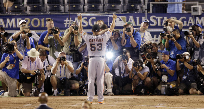 National League's Melky Cabrera of the San Francisco Giants shows off his MVP trophy after the MLB All-Star baseball game against the American League All-Stars Tuesday, July 10, 2012, in Kansas City, Mo. National League won 8-0.  (AP Photo/Charlie Neibergall)