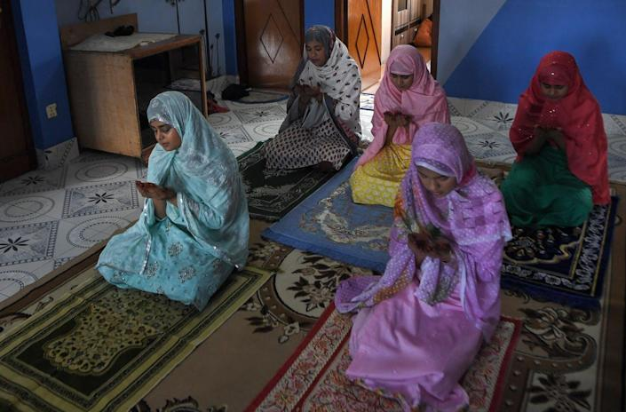 """<span class=""""caption"""">Fasting is one of the five pillars of Islam.</span> <span class=""""attribution""""><a class=""""link rapid-noclick-resp"""" href=""""https://www.gettyimages.com/detail/news-photo/family-members-offer-a-special-prayer-in-their-home-during-news-photo/1232878046?adppopup=true"""" rel=""""nofollow noopener"""" target=""""_blank"""" data-ylk=""""slk:Prakash Mathema/AFP via Getty Images"""">Prakash Mathema/AFP via Getty Images</a></span>"""
