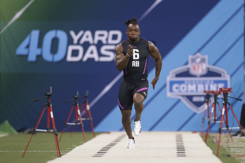 Washington running back Lavon Coleman runs the 40-yard dash at the NFL football scouting combine in Indianapolis, Friday, March 2, 2018. (AP Photo/Michael Conroy)