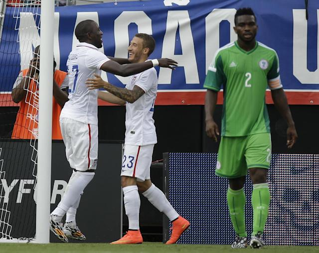 United States's Jozy Altidore, left, celebrates with teammate Fabian Johnson (23) after scoring a goal against Nigeria as Nigeria's Joseph Yobo (2) walks away during the first half of an international friendly soccer match in Jacksonville, Fla., Saturday, June 7, 2014. (AP Photo/John Raoux)