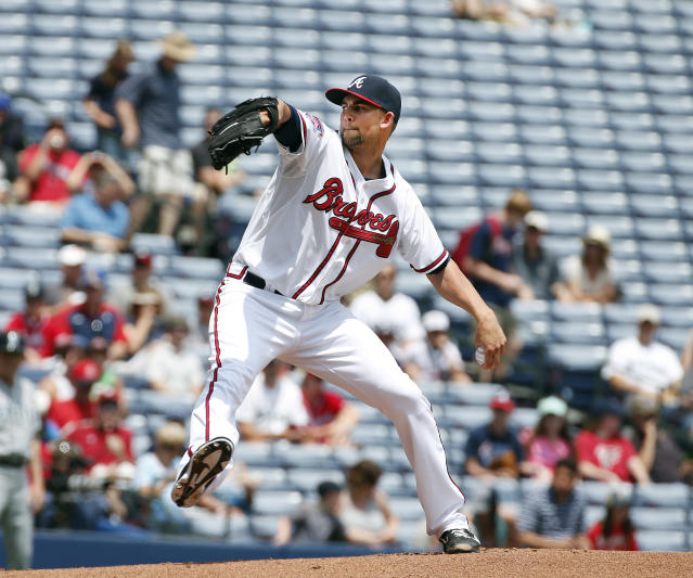 Atlanta Braves starting pitcher Mike Minor works in the first inning of a baseball game against the Seattle Mariners Wednesday, June 4, 2014 in Atlanta. Seattle won 2-0. (AP Photo/John Bazemore)