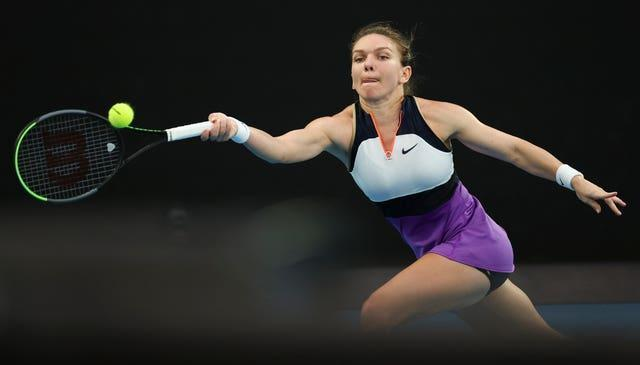 Simona Halep stretches for a forehand during her defeat by Serena Williams