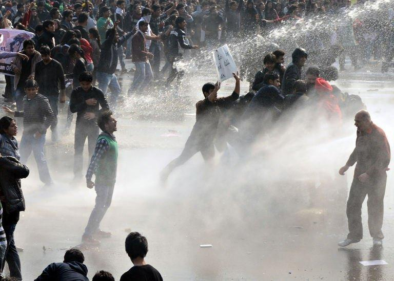 Police unleash water cannon during a protest calling for better safety for women, in New Delhi, on December 22, 2012