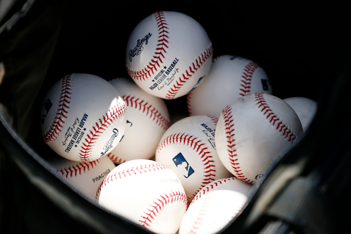 VARIOUS CITIES, - MARCH 12: A detail of baseballs during a Grapefruit League spring training game.