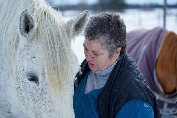 Horse whisperer Liz Tompkins of Kindred Rescue Farm has a moment with her favourite, Rhea.