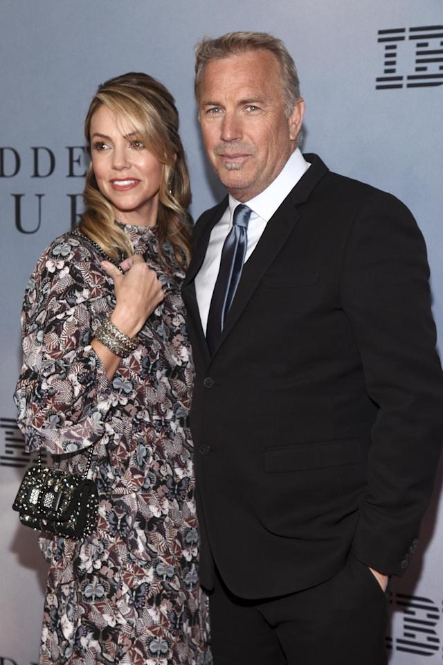 """Christine Baumgartner, left, and Kevin Costner, right, attend the special screening of """"Hidden Figures"""" at the SVA Theatre on Saturday, Dec. 10, 2016, in New York. (Photo by Andy Kropa/Invision/AP)"""