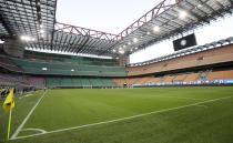 FILE - In this Wednesday, June 24, 2020 filer, Inter Milan and Sassuolo players observe a minute of silence for the victims of coronavirus before the Serie A soccer match between Inter Milan and Sassuolo at the San Siro Stadium, in Milan, Italy. For players, the pandemic has meant a congested season that poses fitness challenges, let alone trying to avoid coronavirus infections. Financially playing the delayed tournament is essential for UEFA. For fans, the EURO 2020 24-team event should be the first chance for the widespread return of fans to stadiums across Europe since March 2020, assuming new restrictions aren't imposed. (AP Photo/Luca Bruno, File)