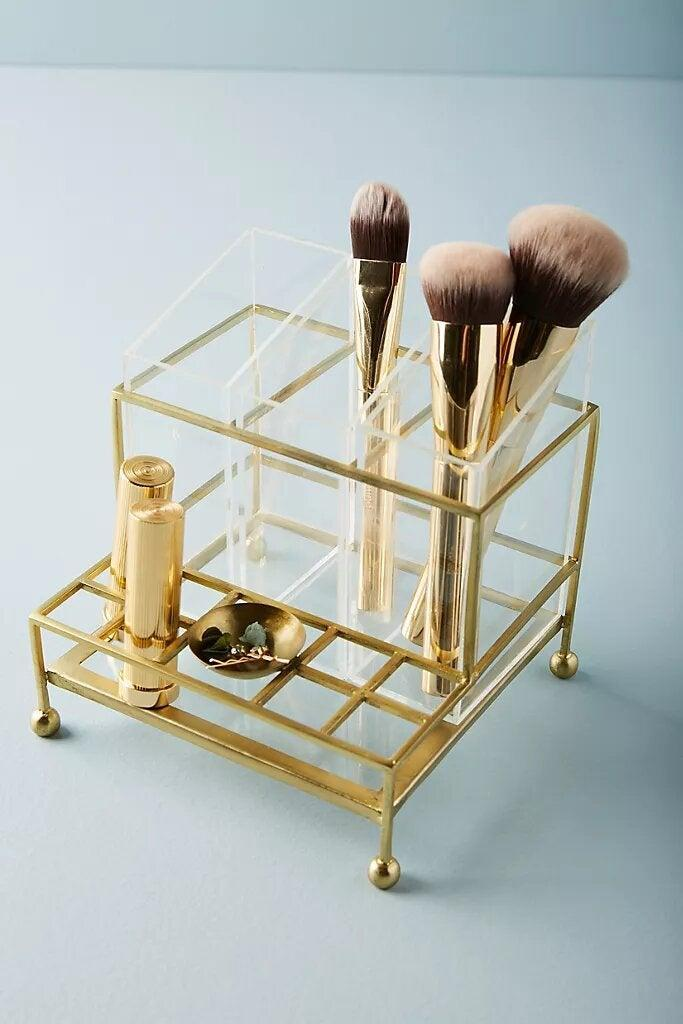 "<h3>Anthropologie Faceted Vanity Organizer</h3><br><strong>The Gold Accent Organizer</strong><br><br><br><strong>The Hype: </strong>4.3 out of 5 stars and 12 reviews on <a href=""https://www.wayfair.com/bed-bath/pdp/dotted-line-cece-makeup-cosmetic-organizer-w001991523.html"" rel=""nofollow noopener"" target=""_blank"" data-ylk=""slk:Anthropologie"" class=""link rapid-noclick-resp"">Anthropologie</a><br><br><strong>Organization Obsessives Say: </strong>""<br><br><strong>Anthropologie</strong> Faceted Vanity Organizer, $, available at <a href=""https://go.skimresources.com/?id=30283X879131&url=https%3A%2F%2Fwww.anthropologie.com%2Fshop%2Ffaceted-vanity-organizer"" rel=""nofollow noopener"" target=""_blank"" data-ylk=""slk:Anthropologie"" class=""link rapid-noclick-resp"">Anthropologie</a>"