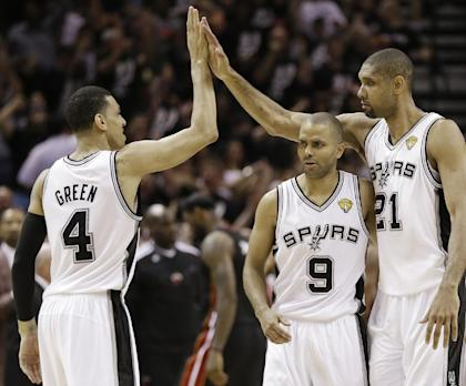 Danny Green celebrates with Tony Parker and Tim Duncan in the second half of Game 5. (AP)