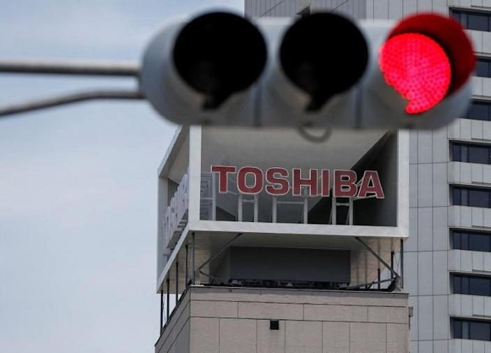 The logo of Toshiba Corp. is seen next to a traffic signal atop of a building in Tokyo